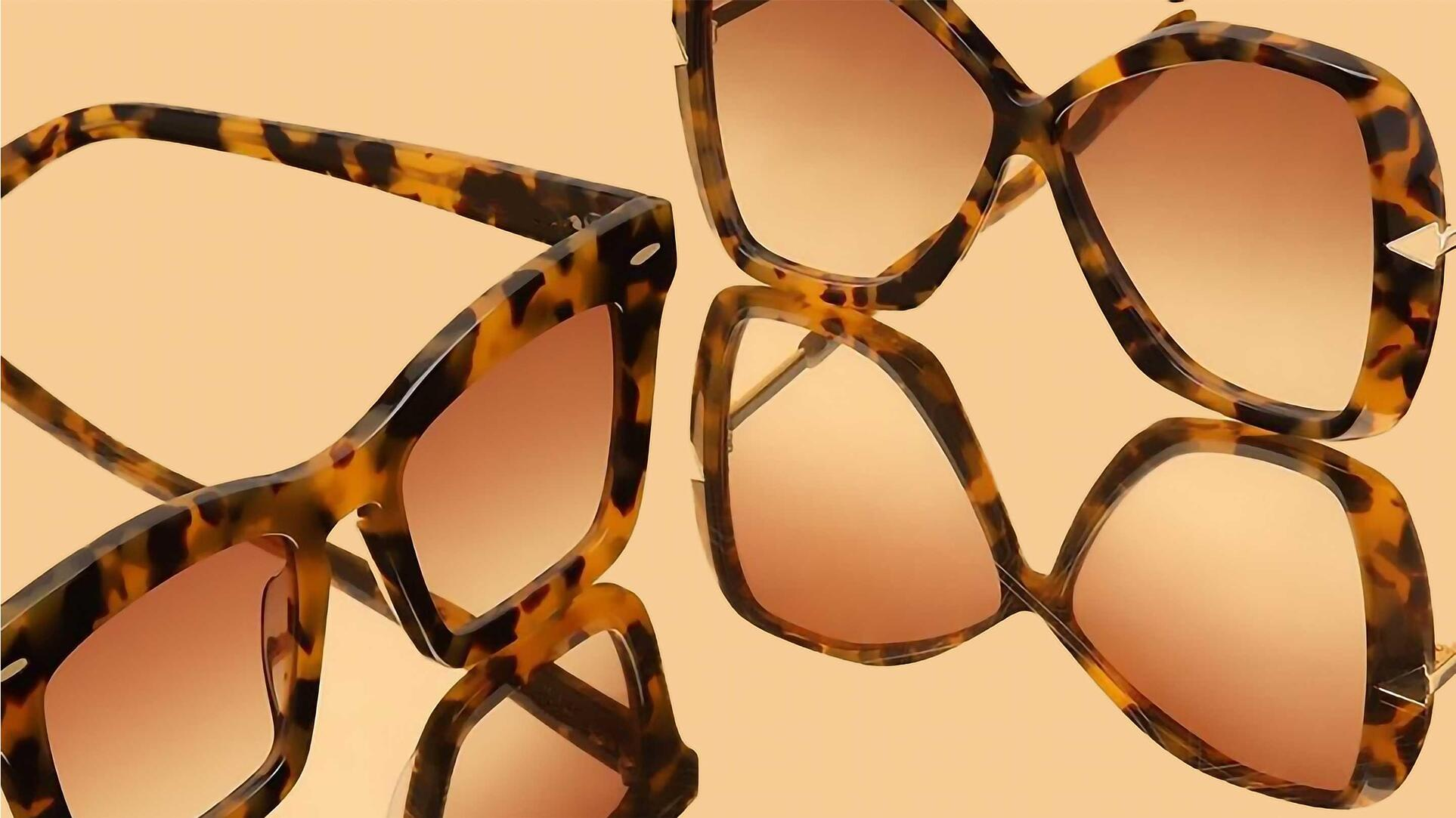 Two pairs of brown tortoise shell pattern glasses.