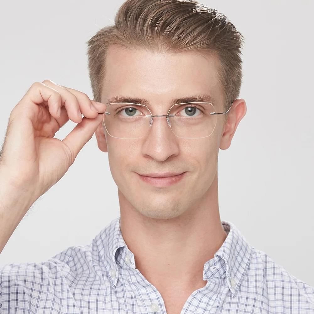 Geometric rimless glasses for men with unique style.